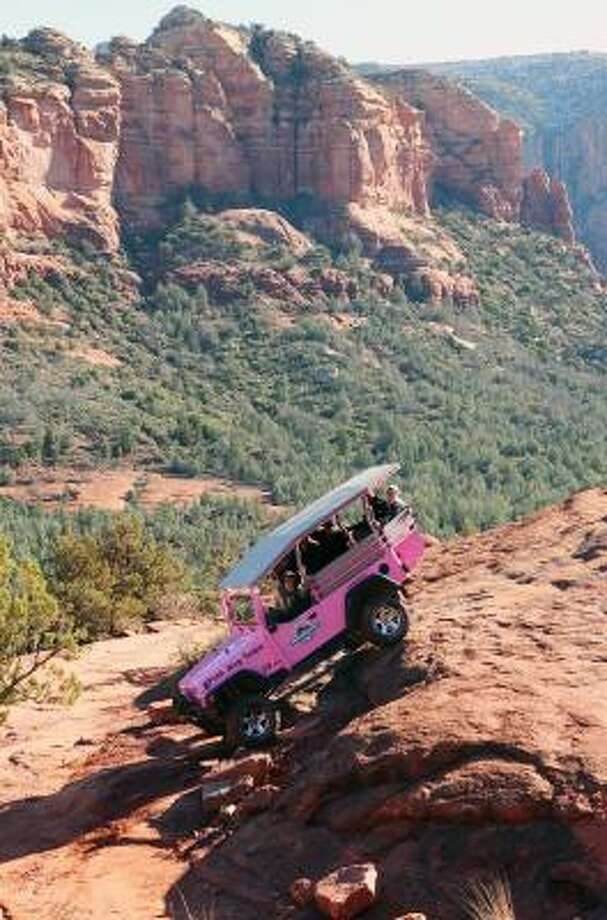 Pink Jeep tours in Sedona, Ariz., may rattle your teeth, but they also provide riveting views of the area. Photo: Ross D. Franklin, AP