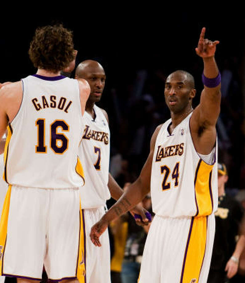 Lakers 92, Celtics 83 Los Angeles Lakers Pau Gasol, Lamar Odom and Kobe Bryant celebrate after defeating the Boston Celtics. Photo: Jeff Lewis, AP