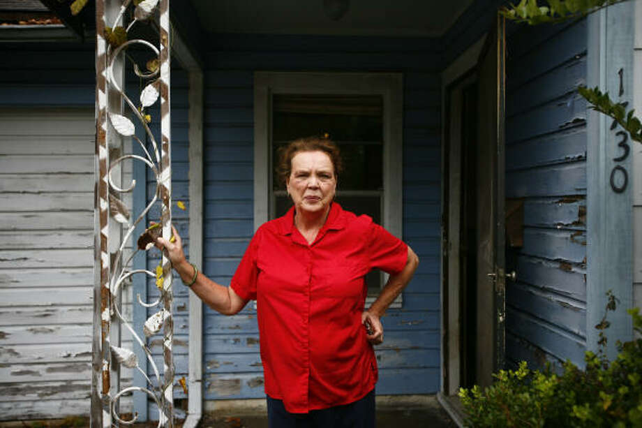 Marsha Farmer stands outside her home, which was flooded by Tropical Storm Allison in 2001. Photo: Michael Paulsen, Chronicle