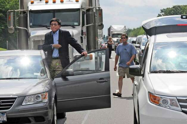 Driver George Chin of New York City tries to see ahead of him, as traffic on the Thruway is stopped due to a gas main break between exits 23 and 24  on Wednesday Aug. 10, 2011 in Albany, NY. He was headed to the Saratoga Race Course. Traffic was eventually routed east across the median through a newly cut guardrail.  (Philip Kamrass / Times Union) Photo: Philip Kamrass / 00014197A