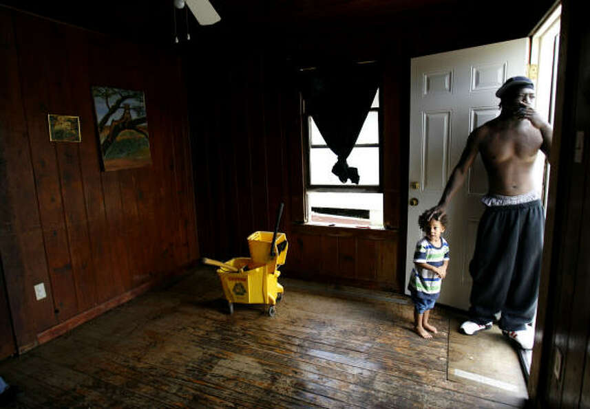 Mopped up  | In the Fifth Ward, Michael Jackson and his son, Howard, 2, stand in Ho