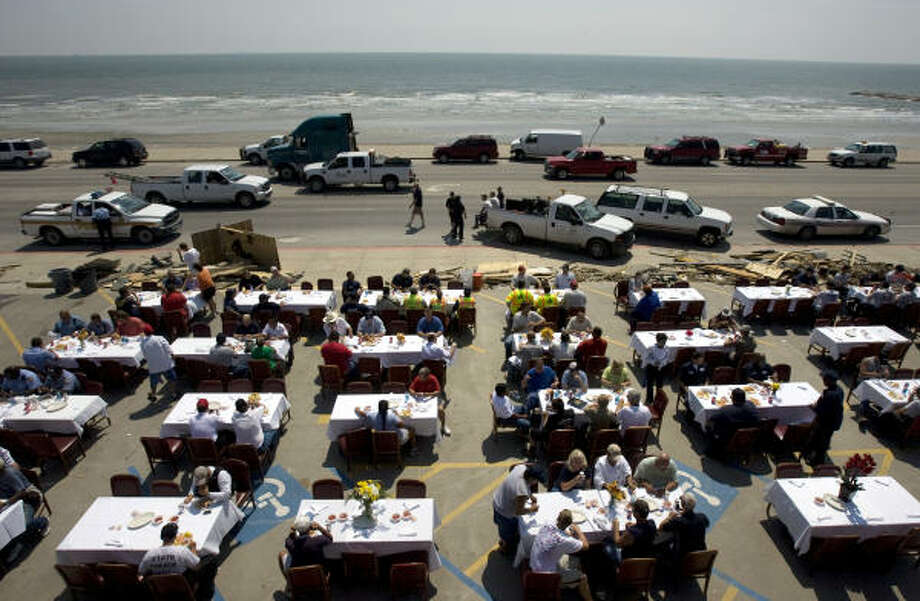 It's on us   | Gaido's Restaurant picked up the lunch tab for first responders and other workers helping clean up storm damage. The well-known eatery on Seawall Boulevard set up tables outside - complete with white linen tablecloths and flowers - and served a shrimp meal at no cost. The restaurant itself suffered major roof damage from the hurricane. | Sept. 18 | Galveston Photo: Johnny Hanson, Houston Chronicle