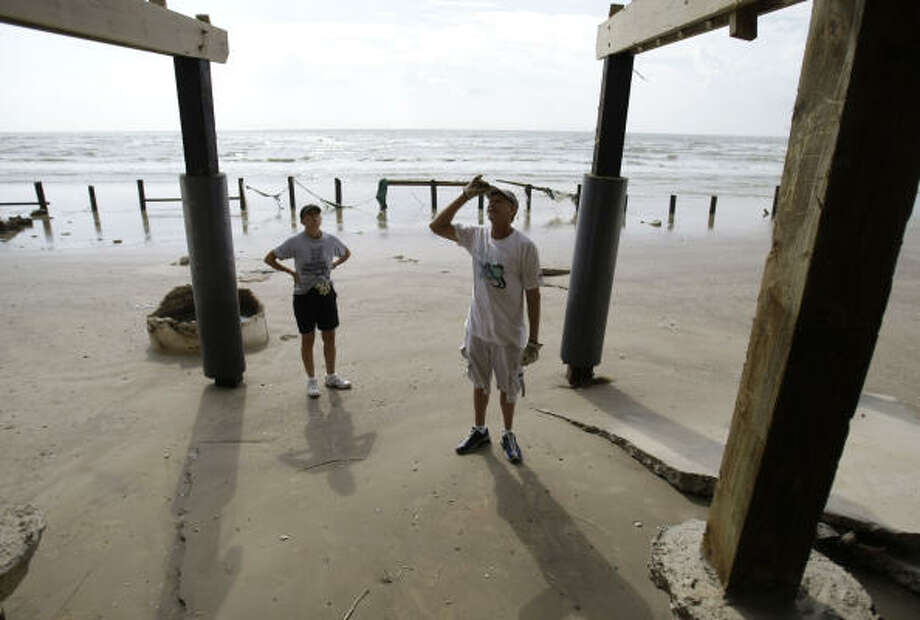 "Lamentation | Art and Christy Picone survey damage to their beach house. ""It was such a beautiful beach,"" said Art Picone, 50. ""It had beautiful dunes, vegetation and walk-overs. Now it's all gone."" 