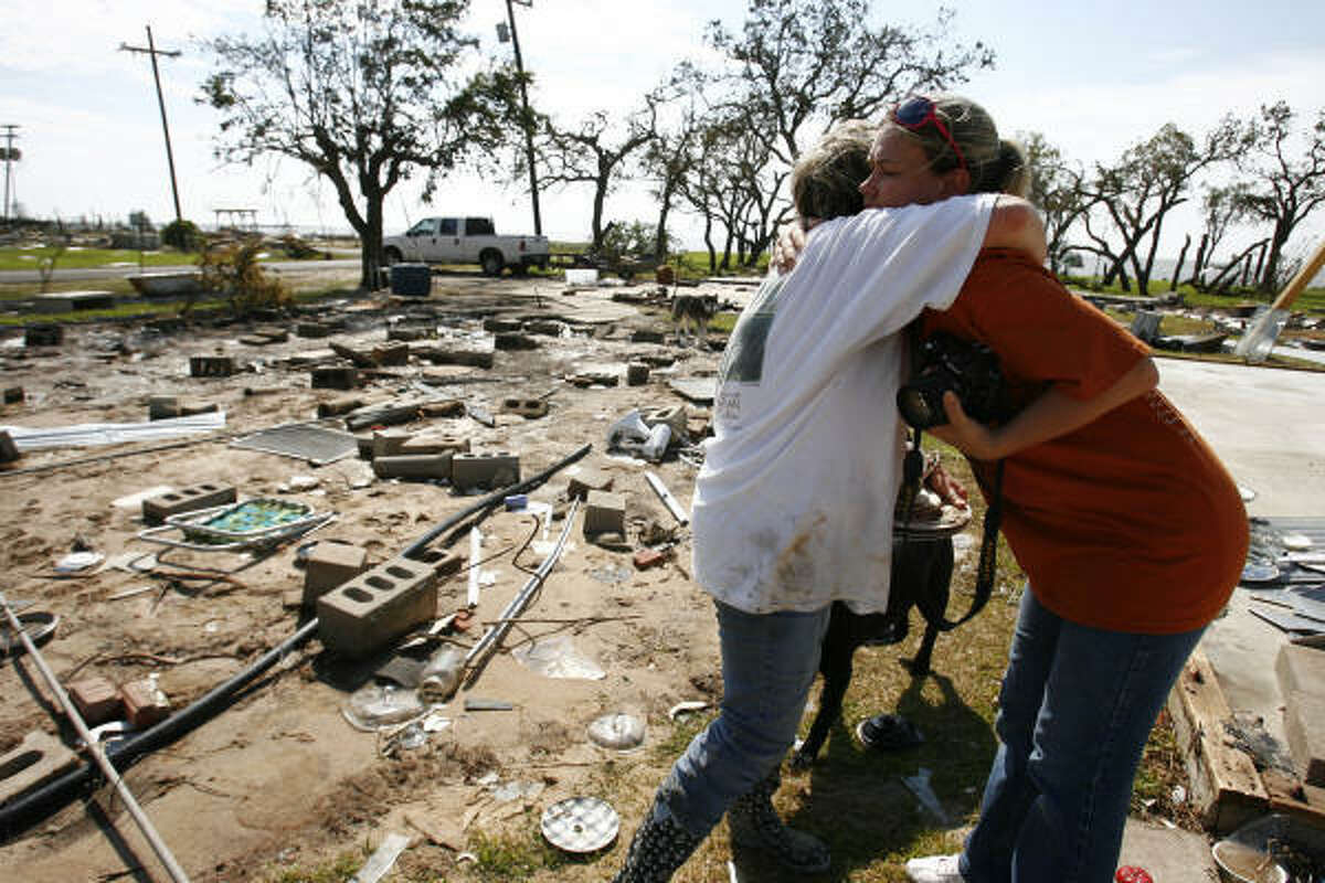 See some of the most powerful images from Hurricane Ike, collected by Houston Chronicle photographers Painful task | Vicky Dearman, left, gets a hug from her friend, Sandra Ysassi, as Dearman sifts through the rubble of her father's home for her family's heirlooms. | Sept. 15 | Oak Island Click through for more photos of the days and weeks following Ike's destructive visit to the area