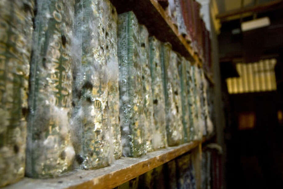 Historic losses | Mold damaged books on the lower floors of the Rosenberg Library, home of the Galveston and Texas History Center. | Sept. 20 | Galveston Photo: Johnny Hanson, Houston Chronicle