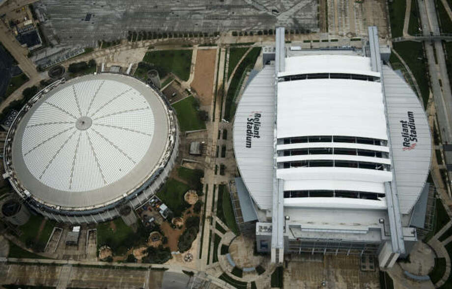 Stadium | Damage to the retractable roof of Reliant Stadium. The Astrodome is at left. | Sept. 13 | Houston Photo: Smiley N. Pool, Houston Chronicle