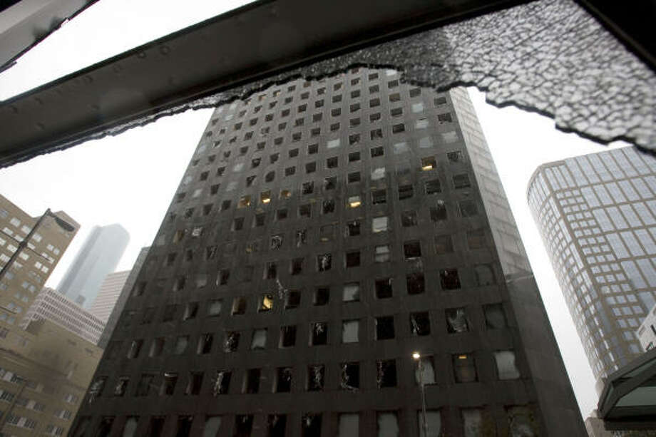 Broken glass   The Chase Tower is pockmarked with blown-out windows.   Sept. 13   Houston Photo: James Nielsen, Houston Chronicle