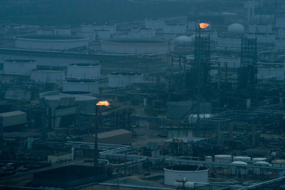 Back to work | Flares light up a refinery as the facility starts up again after the hurricane. | Sept. 13 | Texas City Photo: Smiley N. Pool, Houston Chronicle