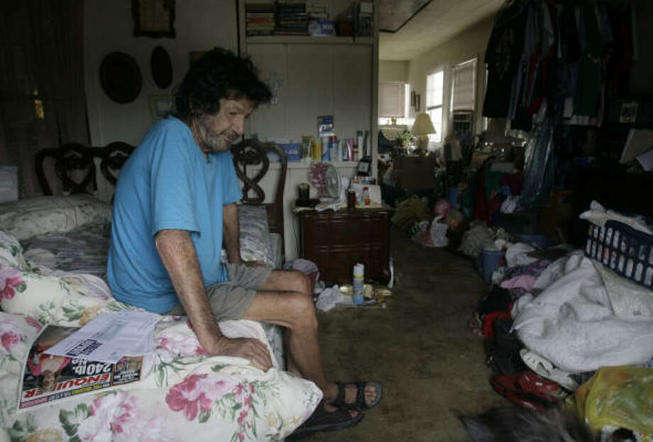 Stranded | Bill Smith, who said he had neither the money nor a car to be able to leave, ducked under the radar of security and emergency personnel and rode out the hurricane in a friendÕs home. | Sept. 14 | Surfside Beach Photo: Julio Cortez, Chronicle