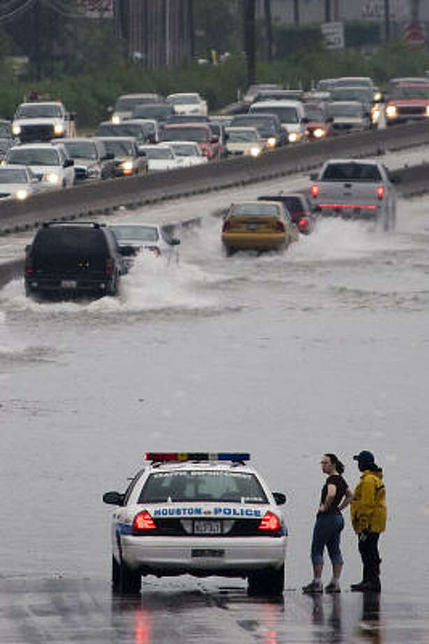 Soggy commute | Traffic gingerly passes through high water on Interstate 45 at Tidwell as the city encounters more rain and flooding. | Sept. 14 | Houston Photo: Smiley N. Pool, Houston Chronicle