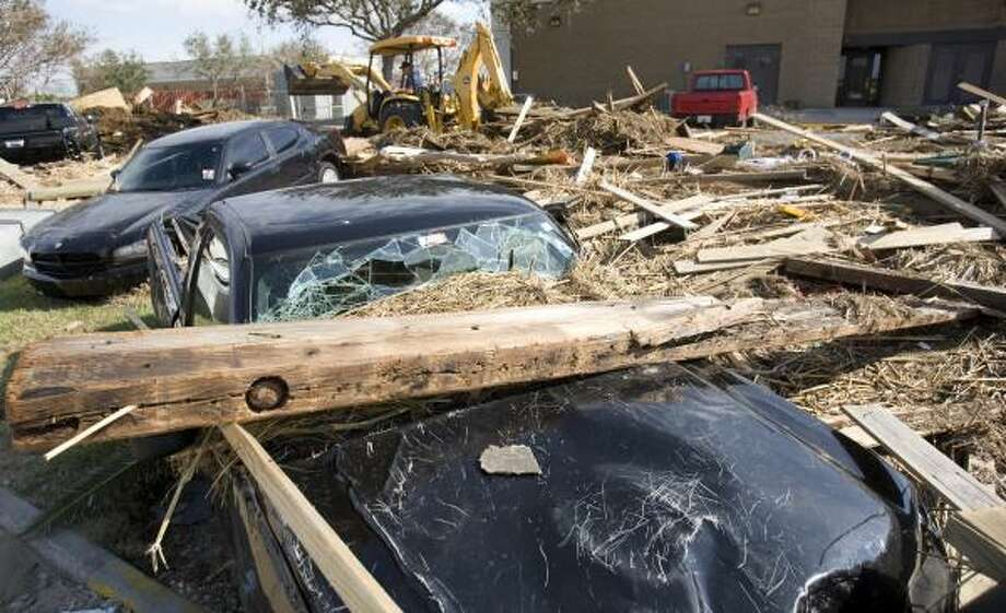 Immovable objects | Cars are trapped under debris at a Coast Guard station. | Sept. 15 | Galveston Photo: Brett Coomer, Houston Chronicle