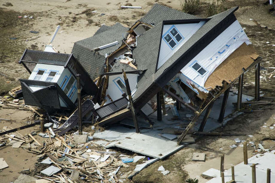 Decimated | A crumpled house lies amid the rubble. | Sept. 15 | Crystal Beach Photo: Smiley N. Pool, Houston Chronicle
