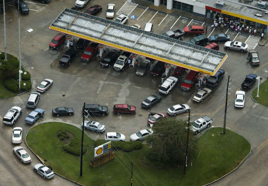 Precious commodity | Long lines form at a Shell station on the corner of Beltway 8 and Veterans Memorial. | Sept. 14 | Houston Photo: Smiley N. Pool, Houston Chronicle