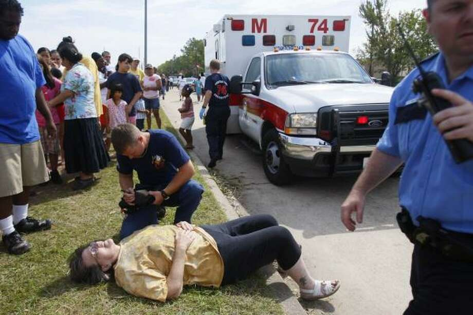 In need | A woman fell ill and was taken to a nearby hospital while waiting in line to get supÂplies such as water, ice and MREs at a FEMA distribution hub on Imperial Valley and Greens. | Sept. 15 | Houston Photo: Mayra Beltran, Houston Chronicle