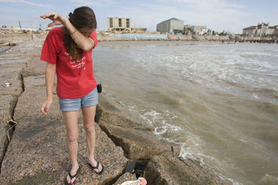 Overwhelmed | Jacqueline Harris wipes tears as she stands on a jetty near 21st and Seawall Boulevard. She is searching for items washed away during Hurricane Ike. | Sept. 15 | Galveston Photo: Brett Coomer, Houston Chronicle