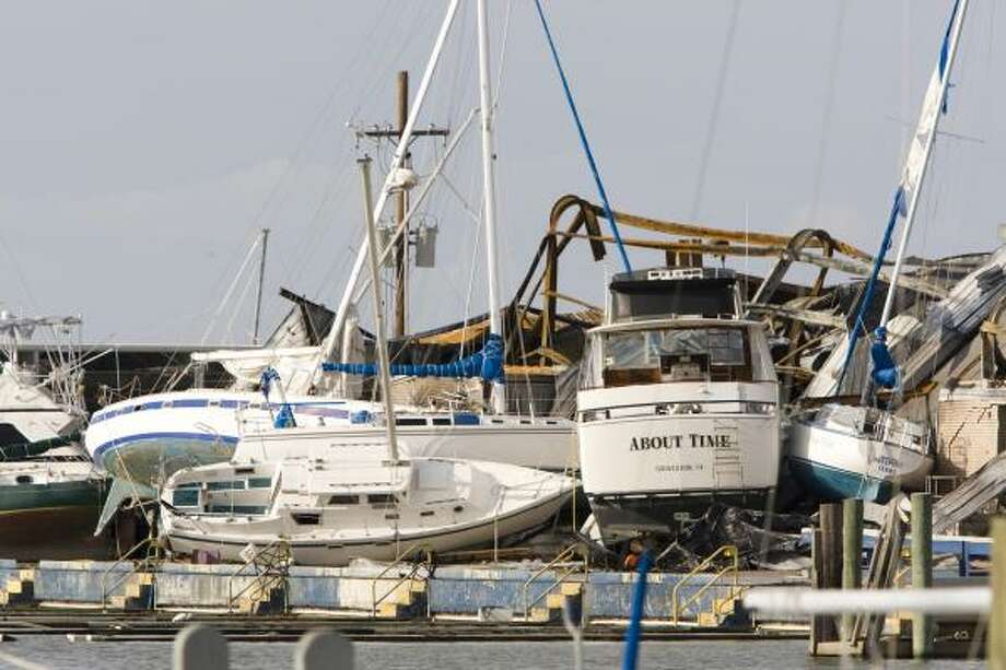 Jumbled| Boats are stacked on top of each other at a marina. | Sept. 15 | Galveston Photo: Brett Coomer, Houston Chronicle