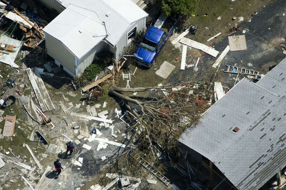 Into the debris | Search teams comb damaged neighborhoods. | Sept. 15 | Port Bolivar Photo: Smiley N. Pool, Houston Chronicle