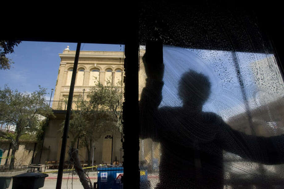 A clearer view| Steven Frasier, a contract worker from Georgia, cleans windows at the Stork Club. | Sept. 18 | Galveston Photo: Johnny Hanson, Houston Chronicle