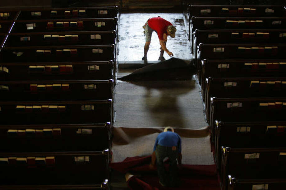 House of worship  | Workers remove wet carpet at the historical Trinity Episcopal Church, which flooded during the hurricane. | Sept. 18 | Galveston Photo: Mayra Beltran, Houston Chronicle