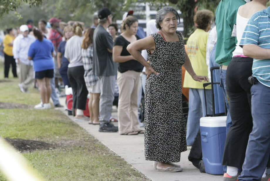 Essentials  | Amelia Aguilar, 65, waits in line at a FEMA distribution site. She arrived at 5:30 a.m. to be one of the first people to get supplies when the site opened at 9 a.m. | Sept. 18 | Houston Photo: Julio Cortez, Houston Chronicle