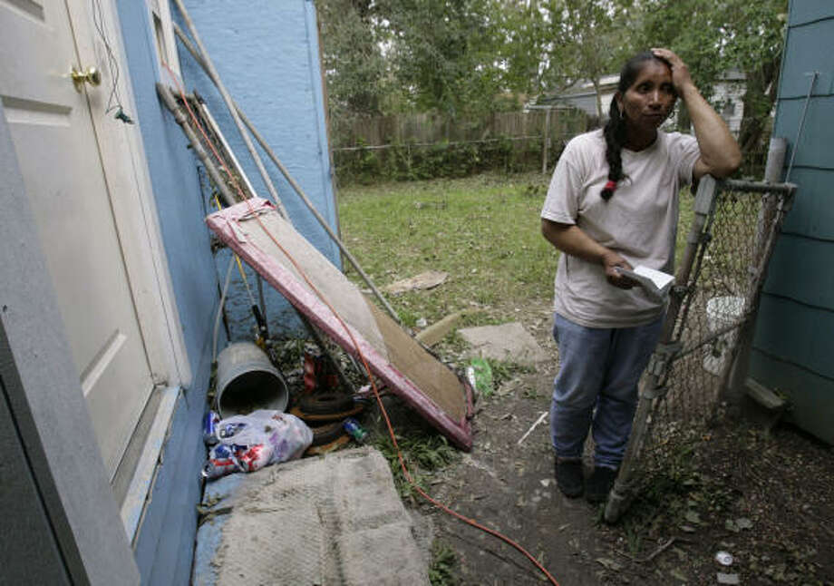Victimized   | Maria Morales, 60, said bad luck continued to pile up after the hurricane. Not only was her home on Whitaker damaged, she said, but the generator she was using to light her home was stolen from her back yard. | Sept. 18 | Pasadena Photo: Julio Cortez, Chronicle