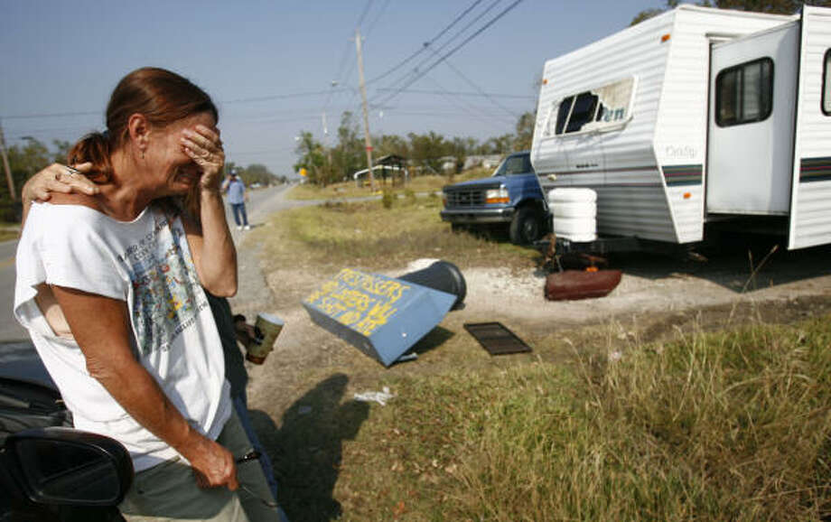 "Emotions   | Elizabeth Jones weeps about a friend who has been missing since the storm. ""I'm scared to call his mother because I don't know where he is or what happened to him,"" said Jones. 