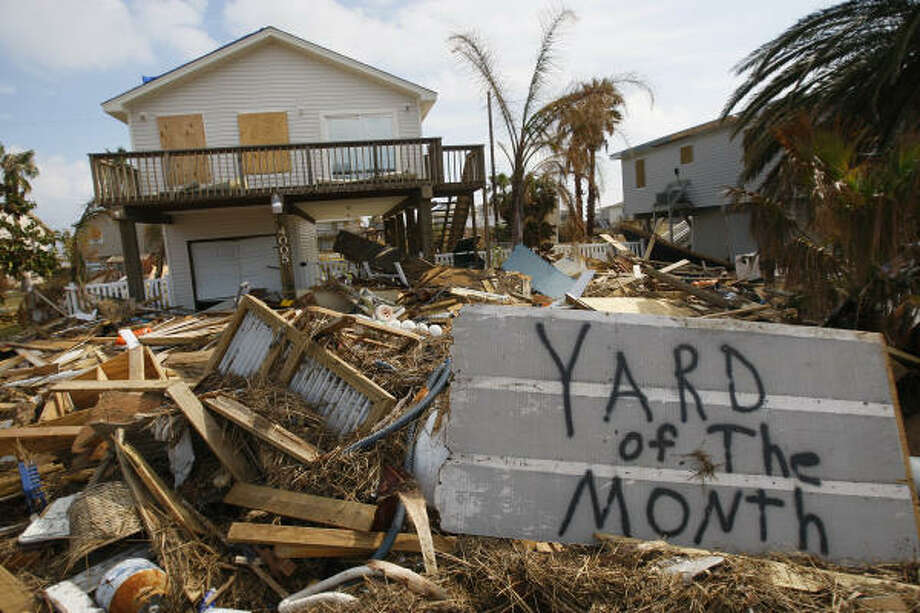 Humor | Debris litters the front yard of a home in the West End's Sea Isle subdivision as residents arrive to assess their homes 10 days after the hurricane. | Sept. 23 | Galveston Photo: Mayra Beltran, Houston Chronicle