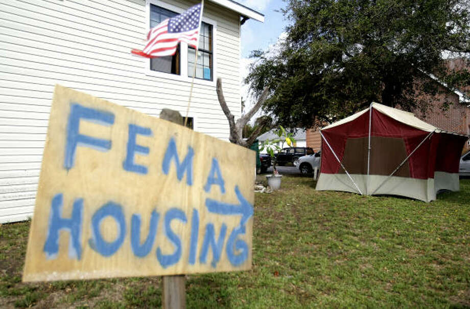 "Sendup  | The Silliman family posted a sign in their front yard pointing to a tent as ""FEMA Housing."" 