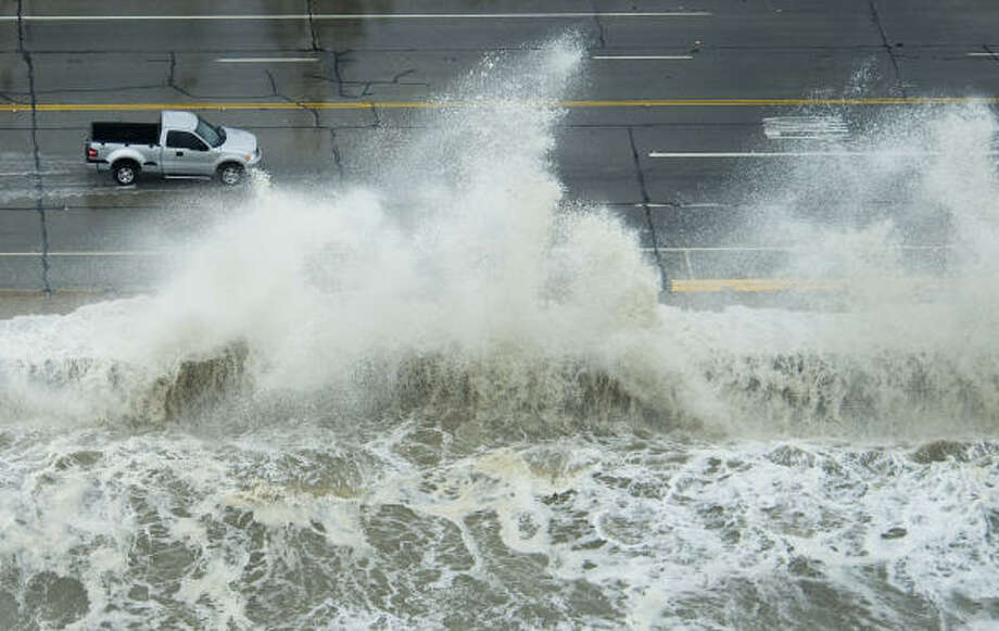 Hazardous driving | A truck ventures out as waves crash over the seawall. | Sept. 12 | Galveston Photo: Smiley N. Pool, Houston Chronicle
