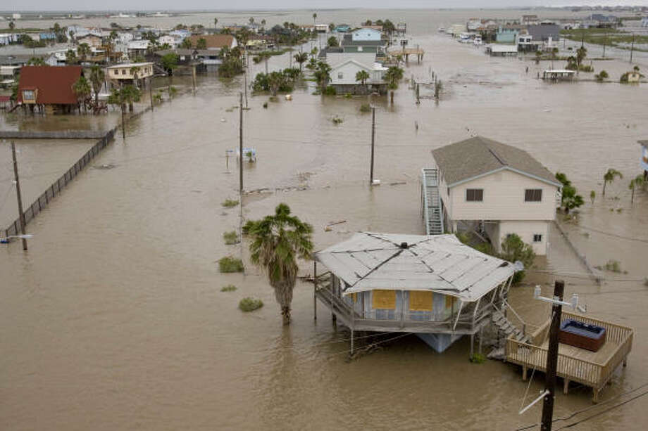 Rising | Floodwaters threaten dozens of homes. | Sept. 12 | Surfside Beach Photo: Brett Coomer, Houston Chronicle