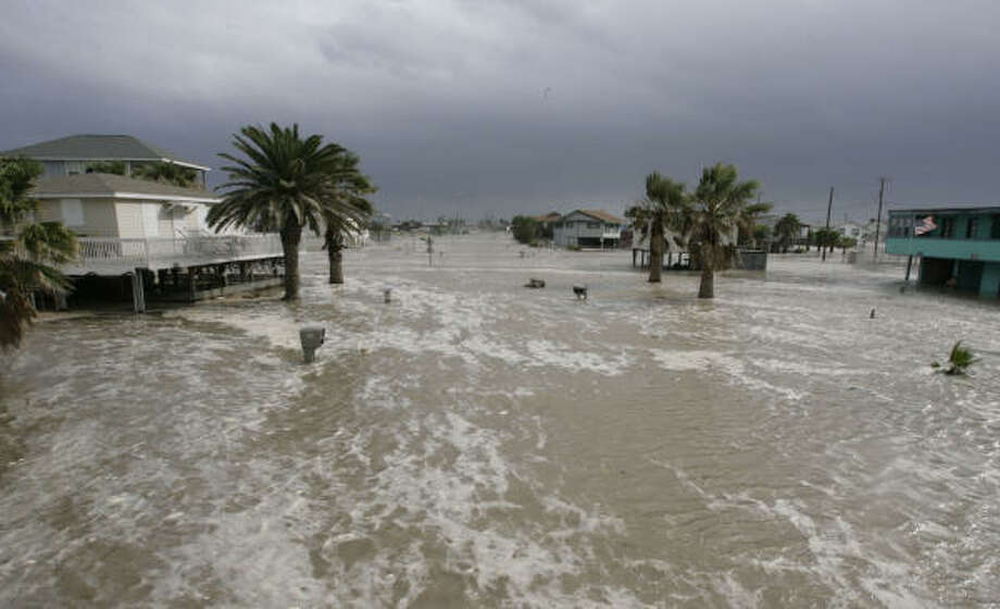 Ocean everywhere | Water from the storm surge continues to rise, nearly topping mailboxes. | Sept. 12 | Surfside Beach Photo: Julio Cortez, Houston Chronicle