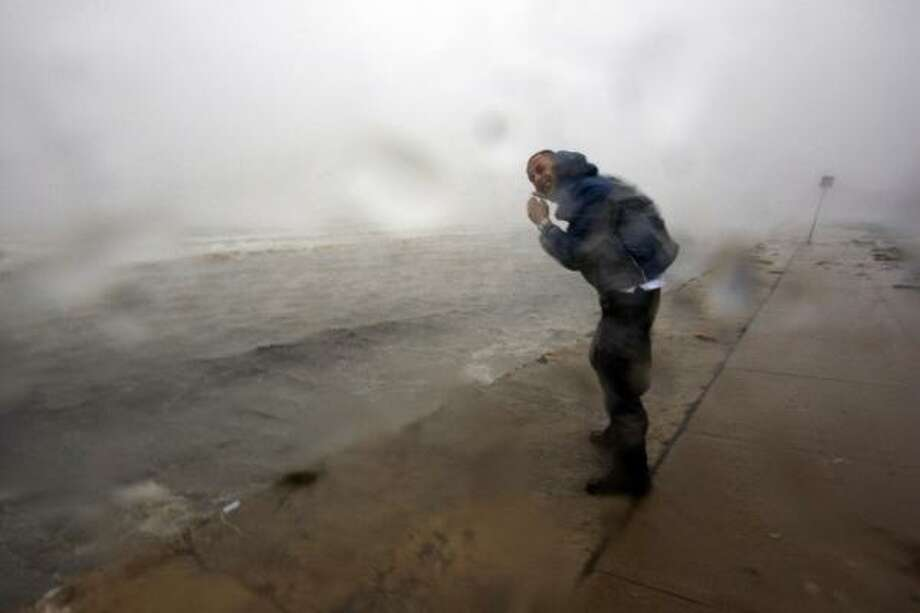 Braving the elements | Stuart Robinson with Cyclone Research Group gets battered by winds and rain as he tries to get a look at the seawall. | Sept. 13 | Galveston Photo: Johnny Hanson, Houston Chronicle