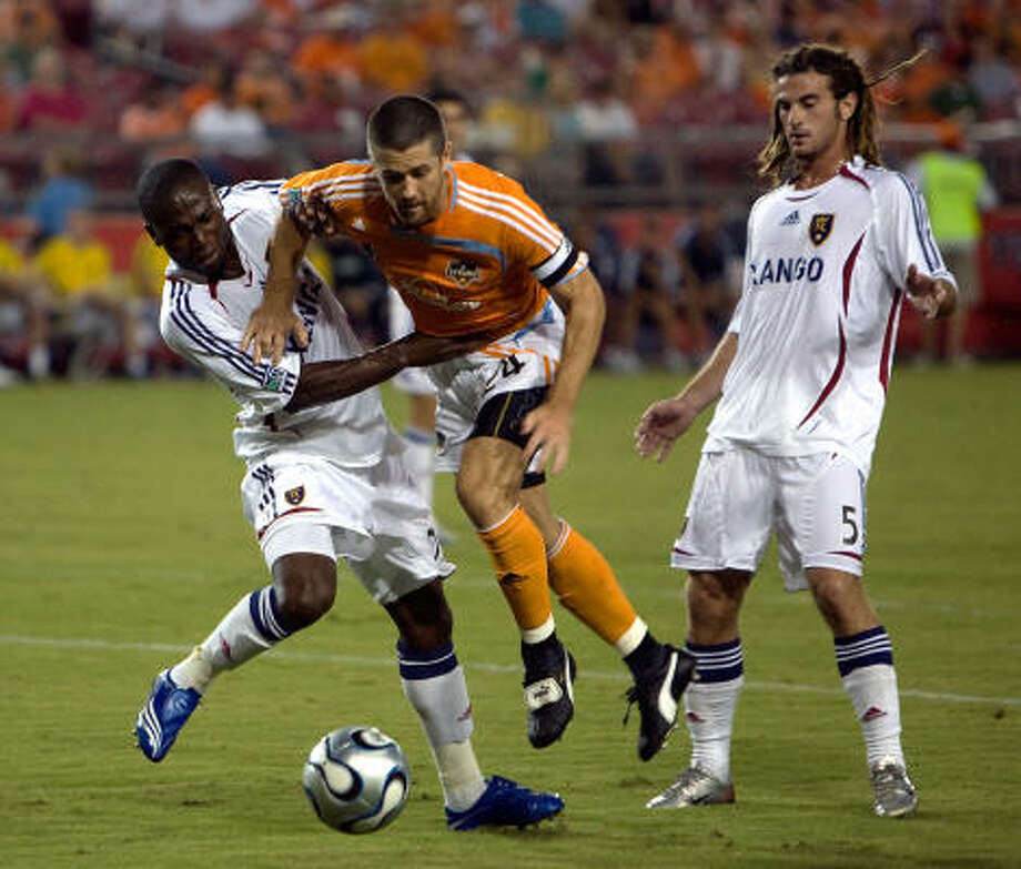 Team captain Wade Barrett, center, was key in helping the Dynamo set MLS records for fewest goals allowed (23) and consecutive minutes without allowing a goal (727) this season. Photo: Bob Levey, For The Chronicle