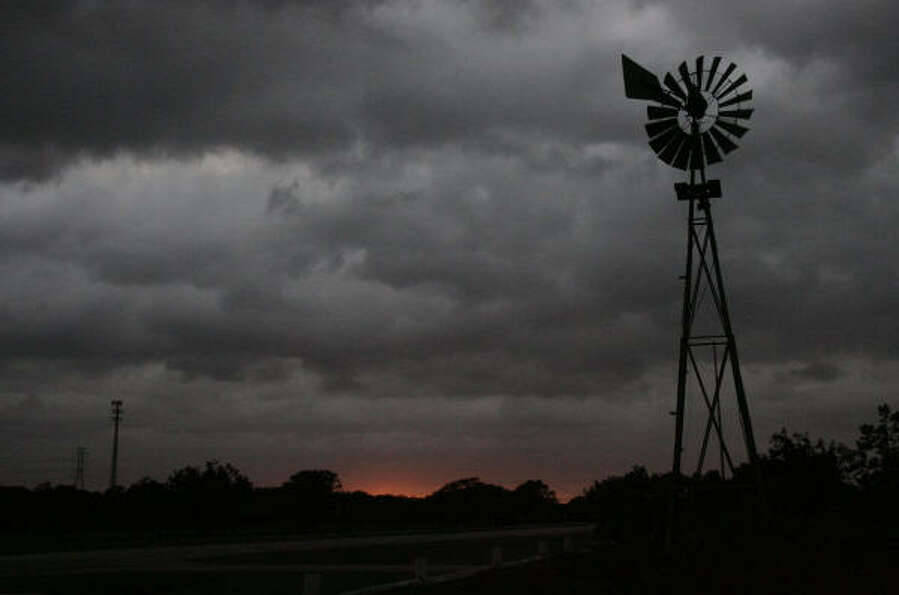Ominous signs | Strong winds spin a windmill as Hurricane Ike approaches. | Sept. 1