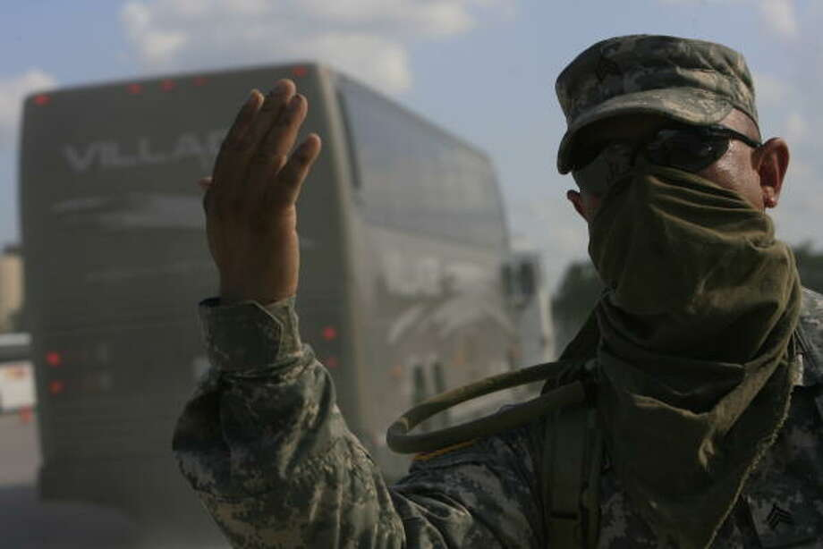 Joint effort| Sgt. Ignacio Rodriguez of Magnolia helps coordinate bus traffic and fueling at the west side's Tully Stadium to support joint operations with the Department of Public Safety and other agencies. | Sept. 10 | Houston Photo: Eric Kayne, Houston Chronicle