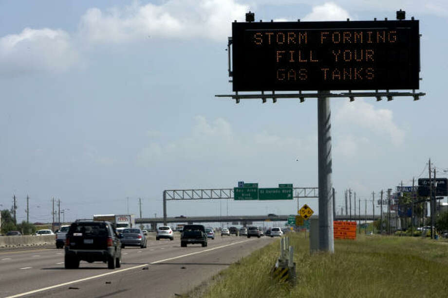 Good advice| A sign on the Gulf Freeway warns motorists to fill up. | Sept. 10 | Clear Lake Photo: Johnny Hanson, Houston Chronicle