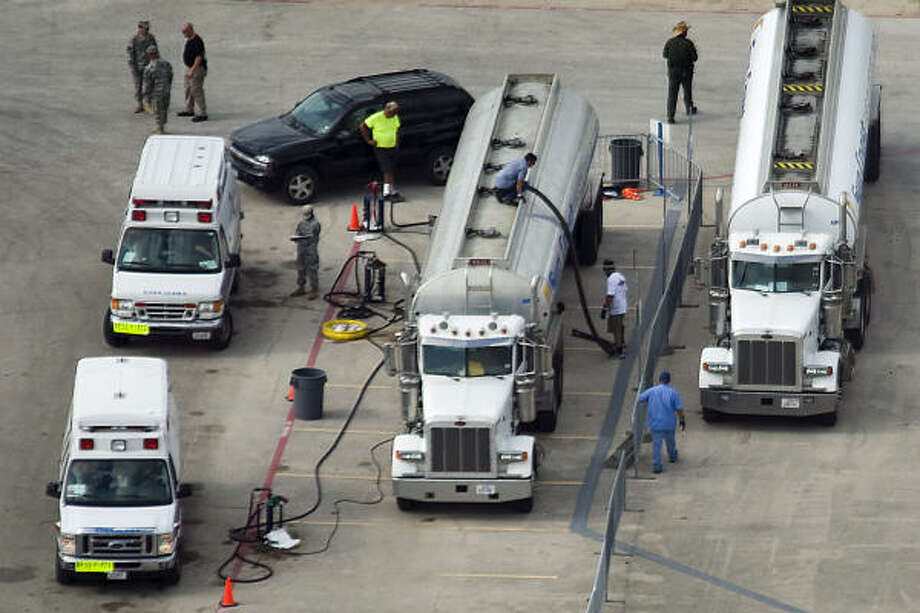 Filling up | Emergency vehicles are fueled at a staging area at Tully Stadium. | Sept. 11 | Houston Photo: Smiley N. Pool, Houston Chronicle