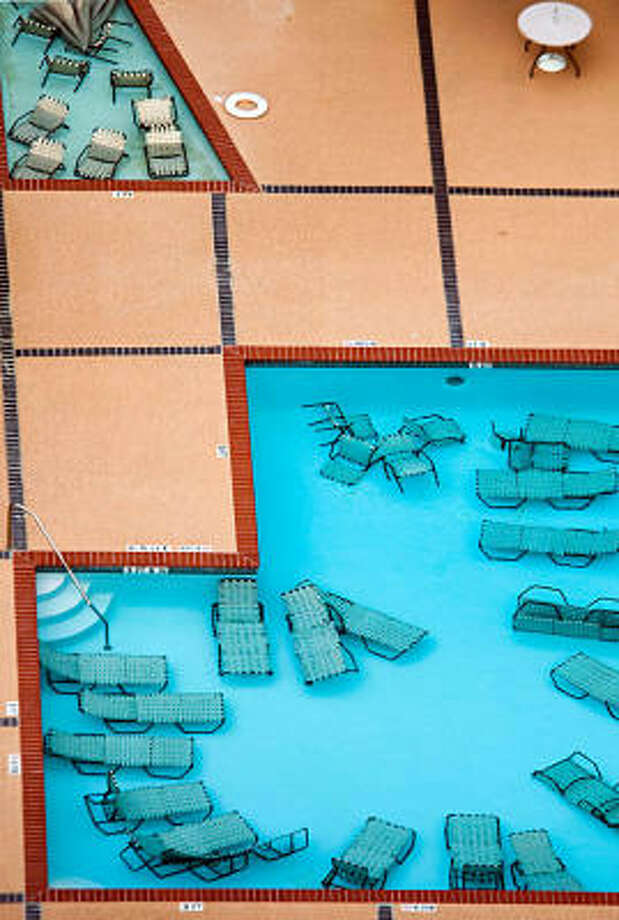 Ingenuity | Patio furniture is submerged for protection in the swimming pool of a westside apartment complex. | Sept. 11 | Houston Photo: Smiley N. Pool, Houston Chronicle