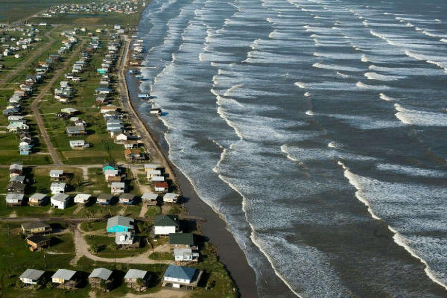 Vanishing   Higher than average surf encroaches on the beach.   Sept. 11   Surfside Beach Photo: Smiley N. Pool, Houston Chronicle