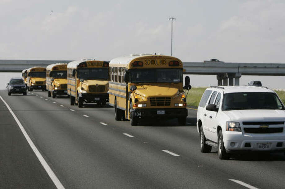 Out of harm's way | Buses from the Alvin Independent School District drive north on Highway 288. | Sept. 11 | Houston Photo: Julio Cortez, Houston Chronicle