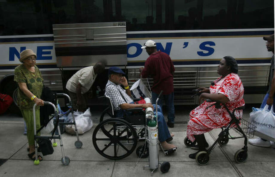 Patience required | Special needs evacuees wait at the George R. Brown Convention Center to board a bus. | Sept. 11 | Houston Photo: Mayra Beltran, Houston Chronicle