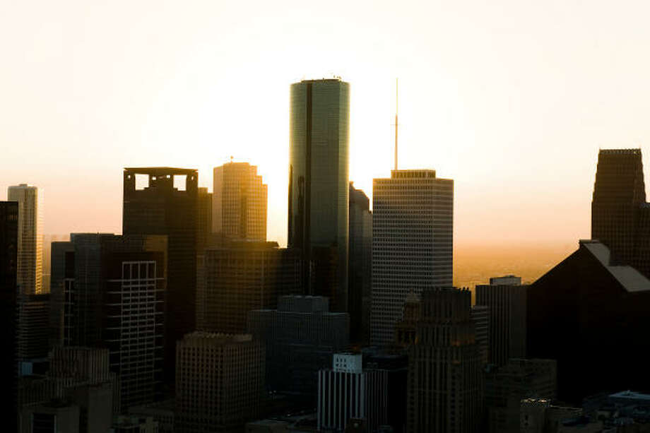 Skylights| As the sun sets on the city, the National Weather Service sternly warns coastal residents to evacuate. | Sept. 11 | Houston Photo: Smiley N. Pool, Houston Chronicle