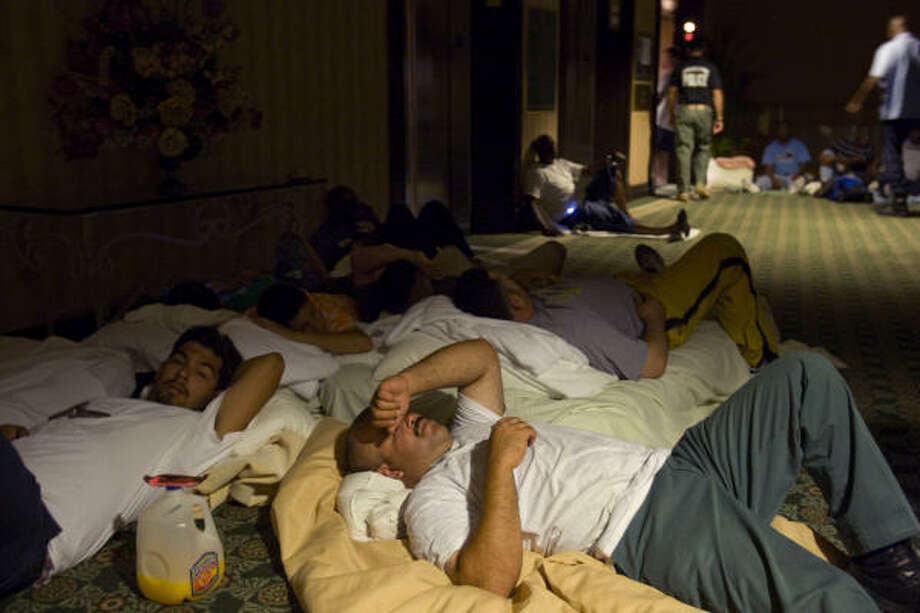 Storm shelter | Some city employees sleep on the floor as they take shelter in the San Luis Hotel. | Sept. 12 | Galveston Photo: Brett Coomer, Houston Chronicle
