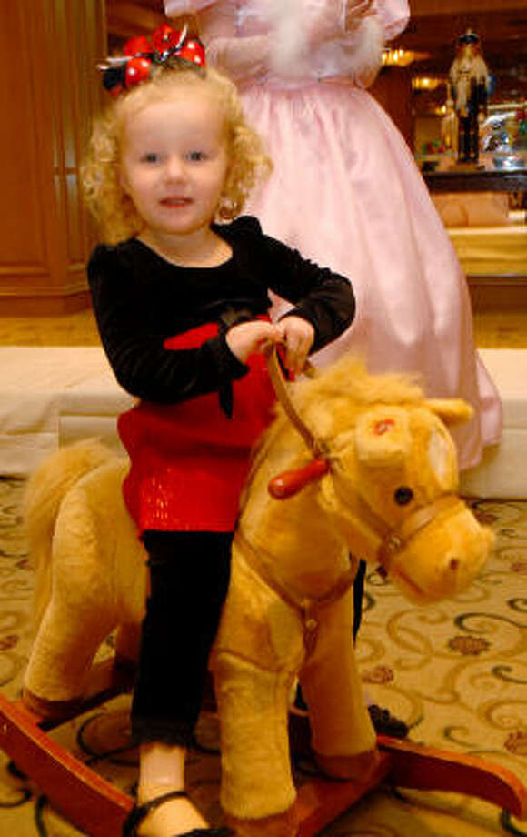Emma Bennett rides a pony at the annual Teddy Bear Tea. Photo: Dave Rossman, For The Chronicle