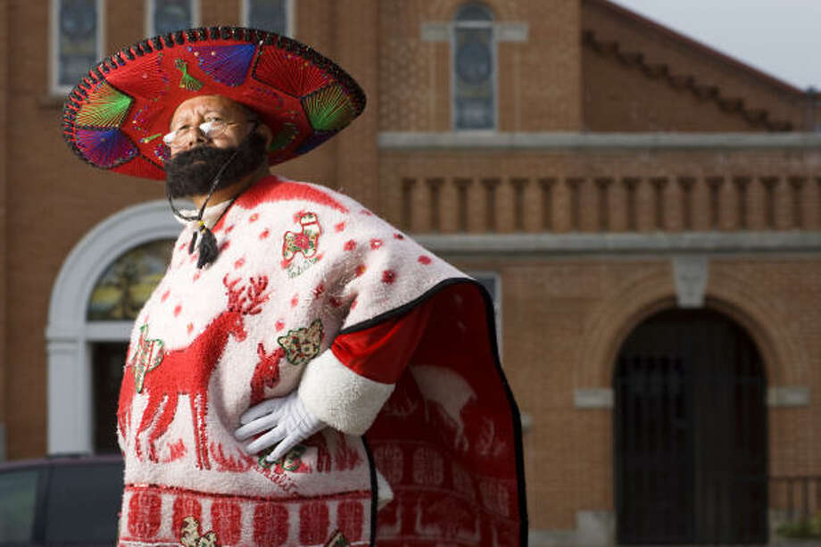 Rudy Martinez, who plays Pancho Claus in San Antonio, spends many December days dressed in his red sombrero and Christmas poncho, handing out presents to needy children. Photo: Nick De La Torre, CHRONICLE