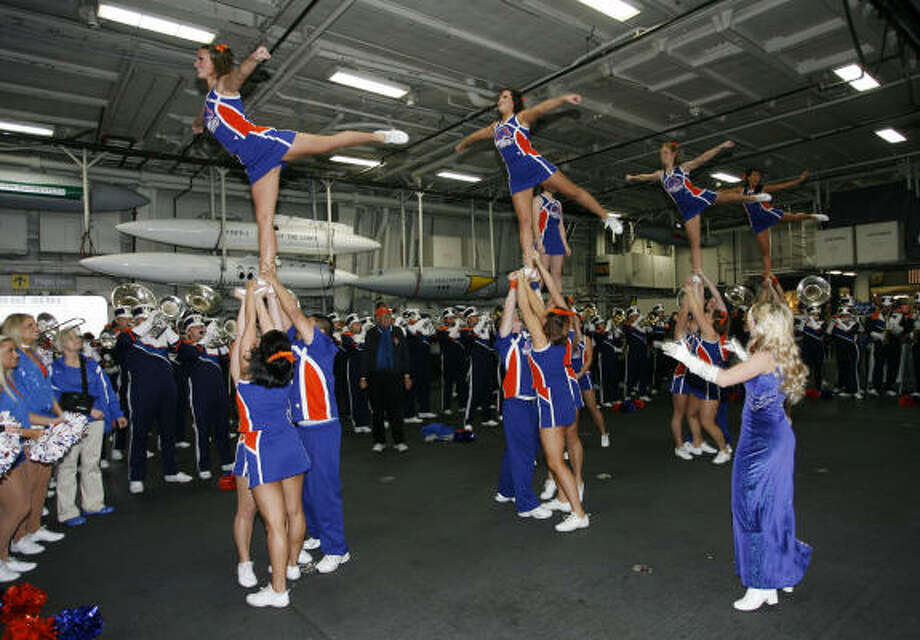 Cheerleaders from Boise State perform on the hangar deck of the retired aircraft carrier USS Midway during a Poinsettia Bowl spirit event in San Diego Monday,  Dec. 22, 2008. Boise State will face TCU in the NCAA college football Poinsettia Bowl Tuesday, Dec. 23. Photo: Denis Poroy, AP
