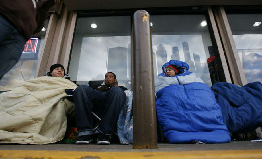 From left, Franklin Chan, Joseph Lewis and Carlos Angeles hold their place in line with 19 other Air Jordan fans at Active Athlete Monday in Houston. Photo: Sharon Steinmann, Chronicle