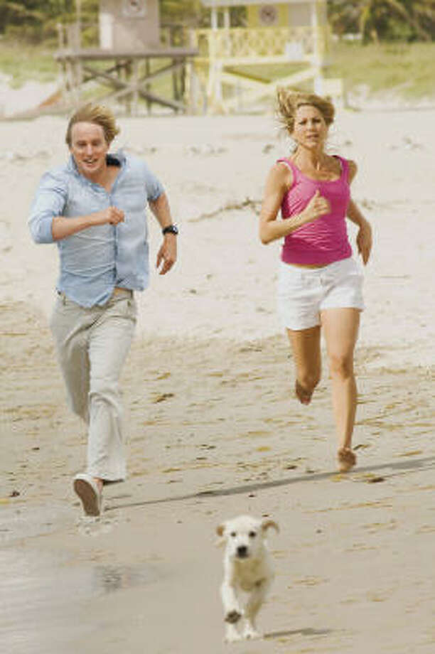 Owen Wilson and Jennifer Aniston play a couple who learns important life lessong from their dog in Marley and Me. Photo: Barry Wetcher, AP