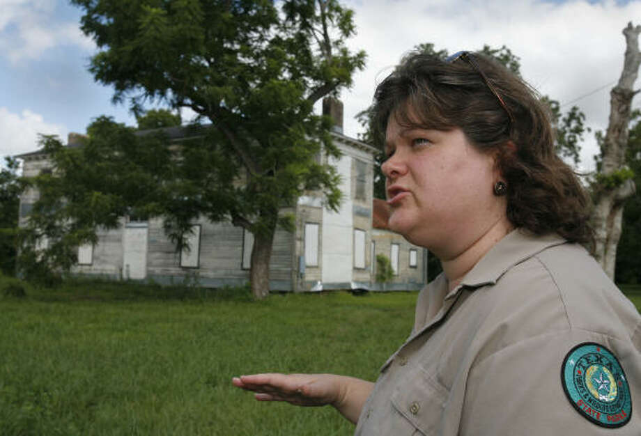 Kandy Taylor-Hille, shown at the Levi Jordan plantation, describes how it isn't getting needed repairs because of lack of tight funding for state parks. Photo: Steve Ueckert, Chronicle File