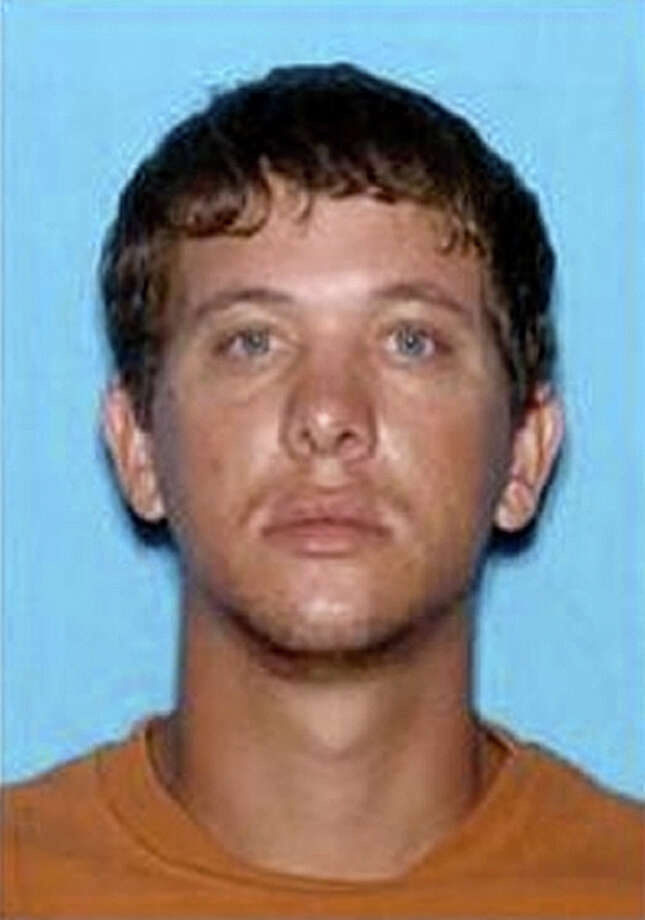 In this undated FBI photo, Dylan Dougherty Stanley, 26, is shown.  Investigators say they received a tip that three Florida siblings accused of firing shots at a Florida police car and then robbing a bank in south Georgia may have traveled to Tennessee. Authorities have been pursuing Ryan Edward Dougherty, Dylan Dougherty Stanley and Lee Grace Dougherty since Tuesday, Aug. 2, 2011. (AP Photo/FBI via the Atlanta Journal & Constitution)